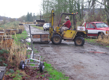 Beekeeper Bowen moves pallets of bees near Big Lake, Washington