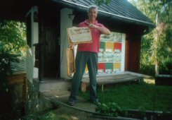Eastern Europe (Caniola) bee house, hives, and beekeeper